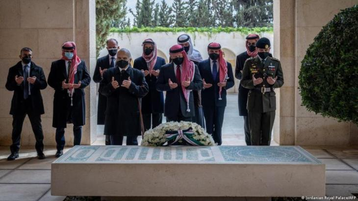 At the grave of their ancestors: Prince Hamzah (second from left) and King Abdullah (just behind the floral decoration) (photo: Jordan Royal Palace/AFP)
