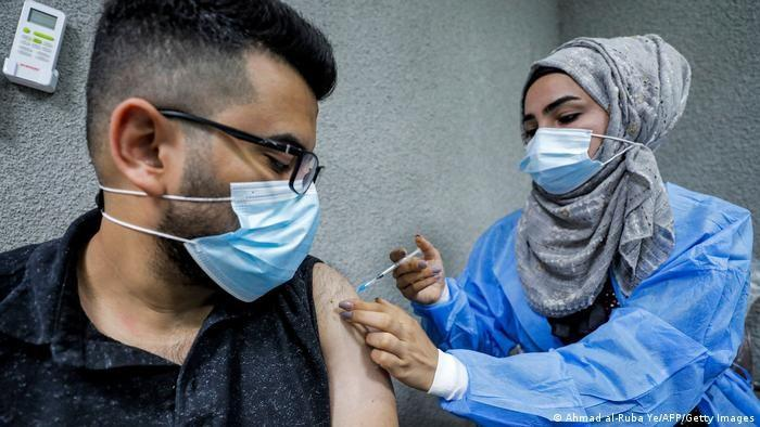 Pfizer BioNTech vaccine being administered by a nurse at Baghdad's Kindi Hospital (photo: Ahmad al-Rubaye/AFP/Getty Images)