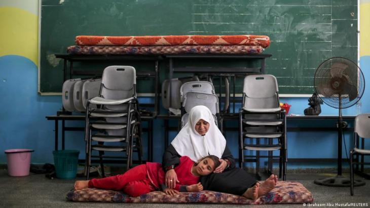 Gaza City: Palestinians seek shelter from airstrikes in a school (photo: Ibraheem Abu Mustafa/Reuters)