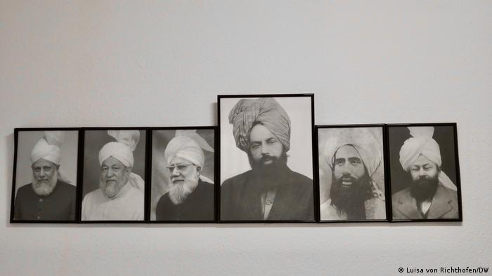 Black and white photos of Ahmadi religious leaders. The Ahmadiyya believe their movement's founder, Mirza Ghulam Ahmad (centre), was a messiah (photo: Luisa von Richthofen/DW)