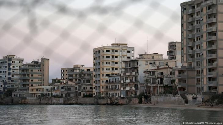The abandoned resort of Varosha, seen through a wire fence (photo: Christina Assi/AFP/Getty Images)