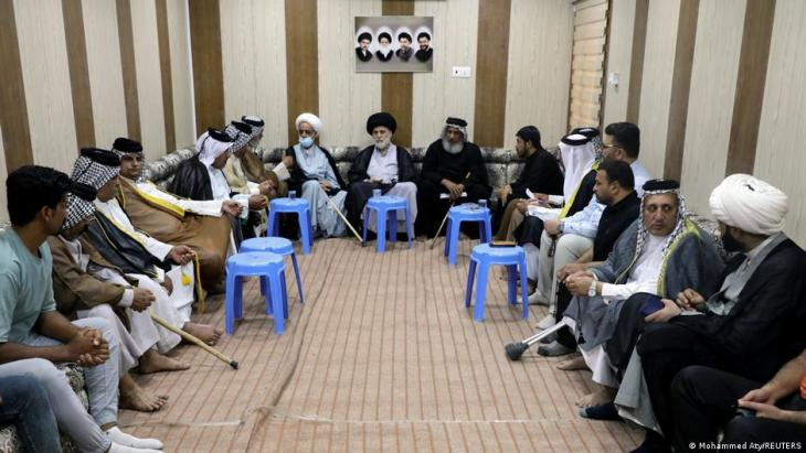 Cleric Hazem al-Aaraji (centre), a senior aide to Muqtada al-Sadr, meets with people in Basra, Iraq 25 May 2021 (photo: Mohammed Aty/Reuters)