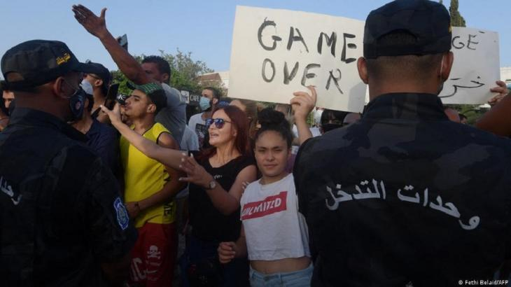 People protest outside the parliament in Tunisia (photo: Fethi Belaid/AFP/Getty Images)