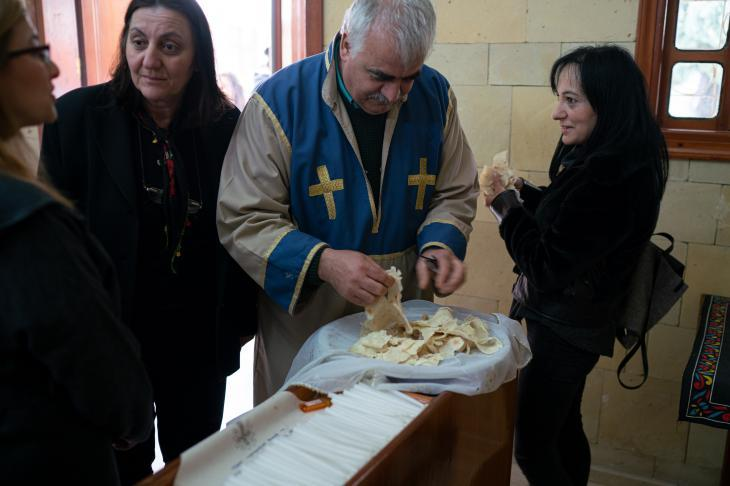 Priest and members of the congregation share traditional lavash bread after the Church service in the village of Vakıflı (photo: Jochen Menzel/transfers-film)