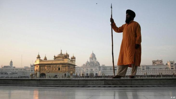 Sikh guard at the Golden Temple in Amritsar (photo: AP)