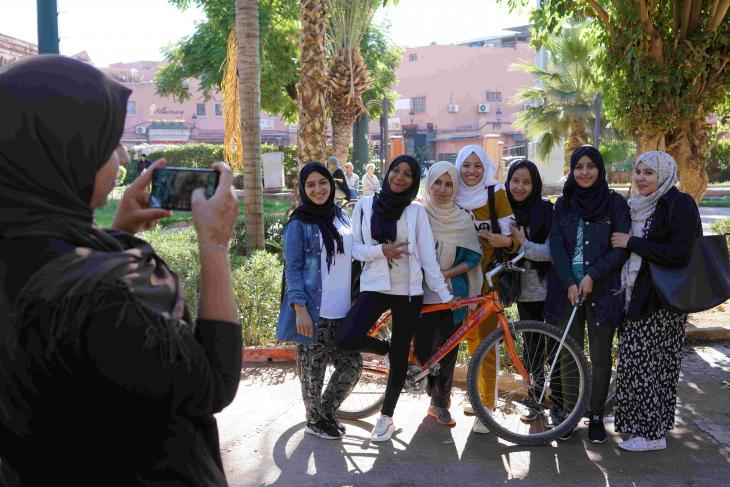 Young women pose for photos with a bicycle, Pikala Bikes, Marrakech, Morocco (photo: Marian Brehmer)