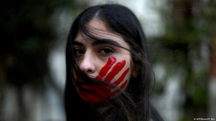 A young woman in Lebanon protesting against domestic violence (photo: AFP/Abaad/P. Baz)