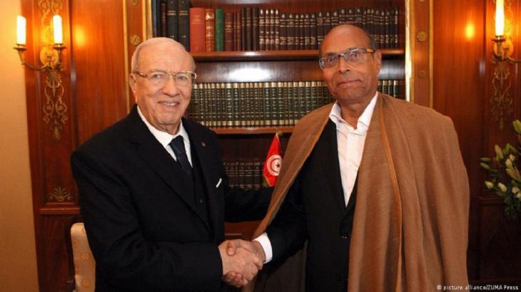 Tunisia's first democratically elected president Beji Caid Essebsi with interim president Moncef Marzouki (photo: picture-alliance/Zumapress)