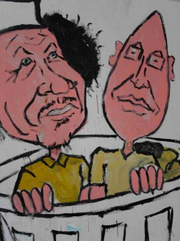 A graffito depicting Muammar Gaddafi and his son Saif al-Islam, who is currently on trial (photo: Valerie Stocker)