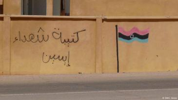 "Graffiti from the ""Martyr Brigade Isseyen"" indicates the presence of rebel forces (photo: Valerie Stocker/DW)"