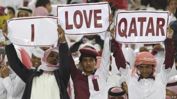 "Young Qatari fans holding up three signs that read ""I Love Qatar"" during a sports event in 2011 (photo: AP)"