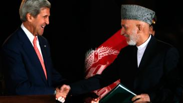Afghanistan's President Hamid Karzai (R) and U.S. Secretary of State John Kerry in Kabul 12 October 2013 after announcing the results of the bilateral security agreement (photo: Mohammad Ismail/Reuters)