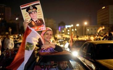 A supporter of Abdul Fattah al-Sisi on Tahrir Square in Cairo (photo: AMR NABIL/AP)