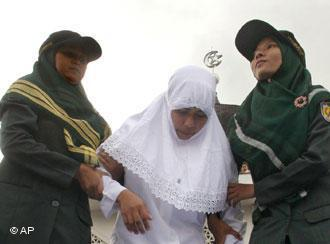 A woman is held by members of the Sharia police in Banda Aceh (photo: AP)