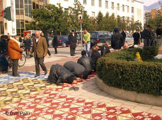 Men praying outside Et'hem Bey Mosque, Tirana, Albania