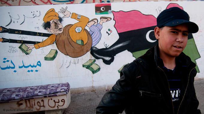 Kick in the backside for Qaddafi