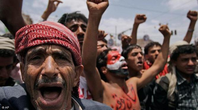 Yemeni opposition protesters celebrate the departure of head of state Ali Abdullah Saleh to attend a clinic in Saudi Arabia. Saleh was injured in a grenade attack on the presidential palace