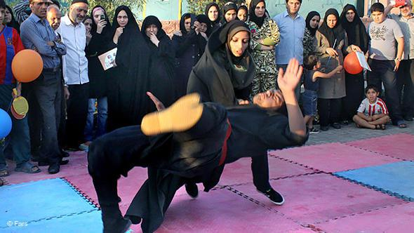 Iranian women participating in a martial arts competition