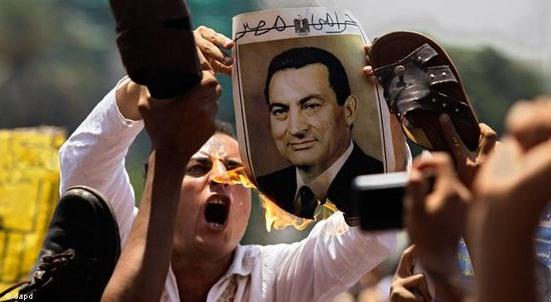 Outright rage: Man burns a portrait of former Egyptian President Mubarak