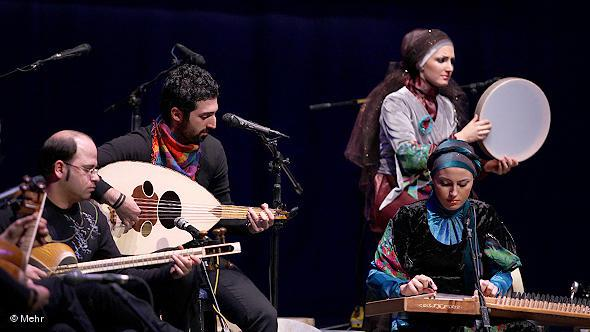 Musicians in a group playing traditional Iranian music