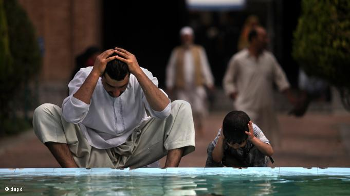 A father and son in Indian Kashmir conduct the cleansing ritual to prepare themselves for the obligatory prayers. Ramadan is also a time devoted to intensive prayer and spiritual reflection