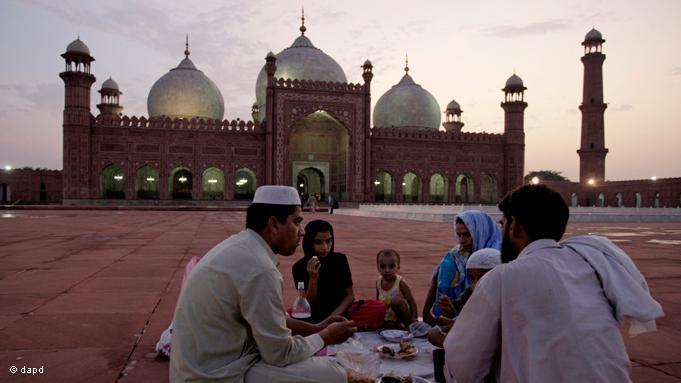 During Ramadan, the ninth month of the Islamic lunar calendar, the breaking of the fast, or ''Iftar'', begins at sunset. A Pakistani family celebrate ''Iftar'' on the square of the 17th century Mughal Badshahi Mosque in Lahore