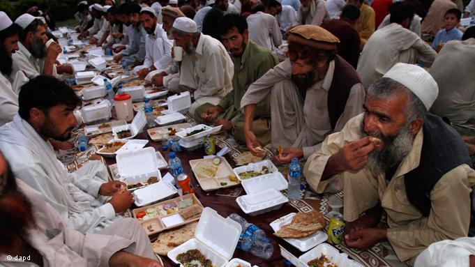 Iftar dinner for jobless men in Afghanistan. Alongside the declaration of faith, daily prayer, the pilgrimage to Mecca and the giving of alms, fasting is, as one of the five pillars of Islam, an integral element of the faith