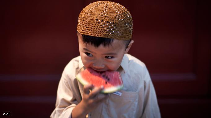 Children, such as this boy, who is a member of the Chinese Hui minority, are exempt from fasting. Pregnant women and the sick are also not required to fast