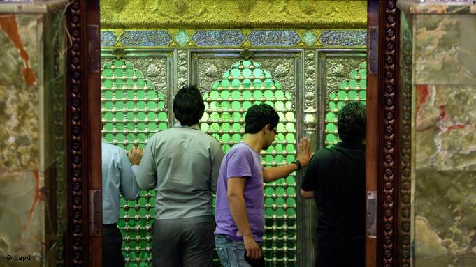 Ramadan sees increased numbers of the faithful visiting holy shrines, to express their wishes and prayers. Iranian Shiites touch the grave of Saleh at his mausoleum north of the capital Tehran
