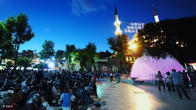Close to the historic Eyüp Sultan Mosque in Istanbul, people enjoy the short night before the next day of fasting begins