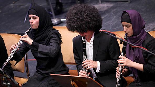 Two female musicians playing in an orchestra