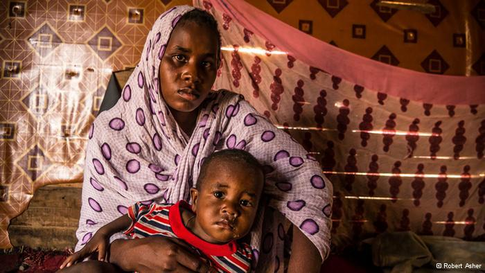 A freed slave woman in Mauritania and her child (photo: Robert Asher)