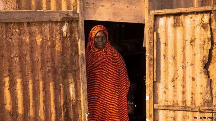 A Hratine woman standing in a doorway (photo: Robert Asher)