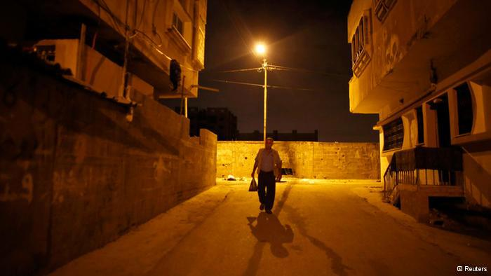 Taysir Abu Sharif Hader is one of 47,000 Palestinians with an official work permit who cross the border from the West Bank every day. Every morning before sunrise, he makes his way to the Qalqilya checkpoint to get to his job in Israel (photo: Reuters)