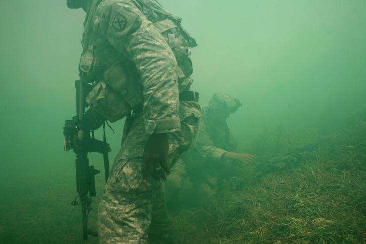 US soldiers on patrol surrounded by green smoke (photo: Michael Kamber)