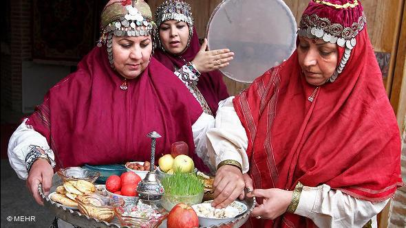 Two women preparing the new year's platter (photo: © Mehr)