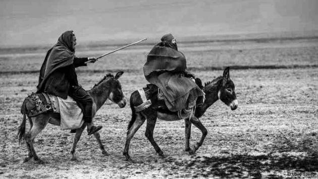 An Afghan man and an Afghan woman travelling by donkey (photo: Majid Saeedi)