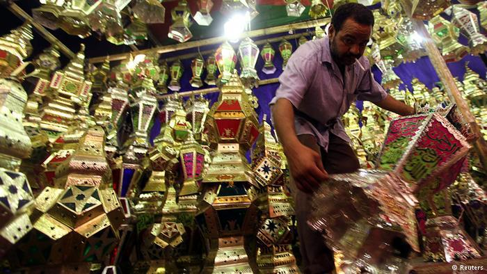 Stallholder with his wares in Cairo. Photo: Reuters