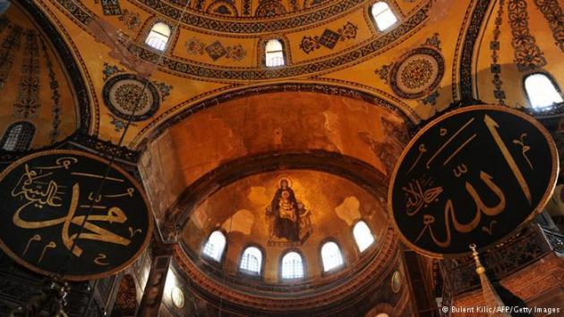 Interior of Hagia Sophia showing Islamic calligraphy and Christian fresco. Photo © Bulent Kilic/AFP/Getty Images
