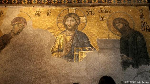 Partially restored 14th century mosaic from Hagia Sophia depicting Jesus, Mary and John. Photo © STR/AFP/Getty Images