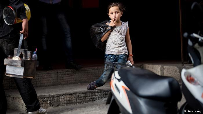 A Syrian refugee child selling tissues on a Beirut street (photo: Amy Leang)