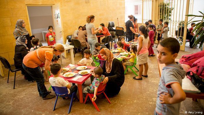 Children eating lentils, Karam Zeitoun School, Beirut (photo: Amy Leang)
