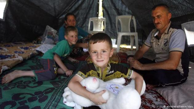 A family in a UN refugee camp (photo: picture-alliance/dpa)