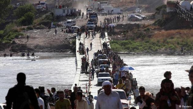 Yazidi refugees returning to Iraq from Syria (photo: Reuters)