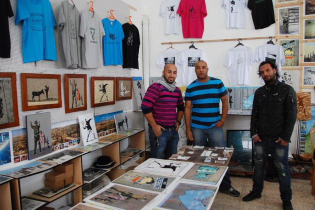"Yamen Elabed and two colleagues from ""Banksy's Shop"" in Bethlehem (photo: Laura Overmeyer)"