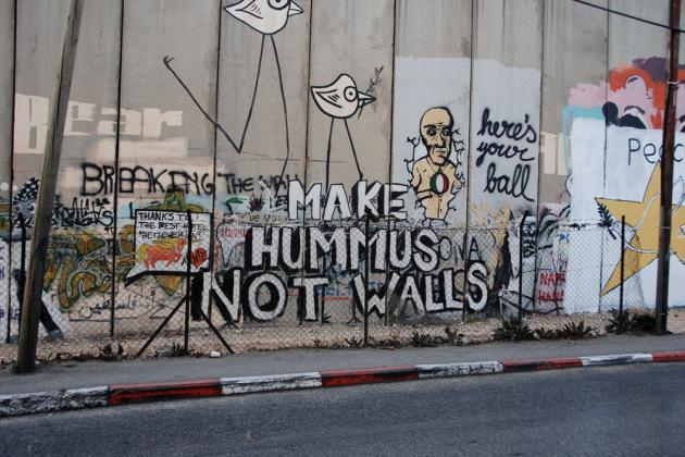 """Graffiti that reads """"Make hummus not walls"""" (photo: Laura Overmeyer)"""
