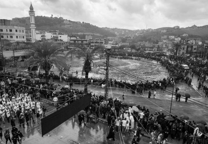 The procession of tatbir practitioners circles around the area where the Battle of Karbala is re-enacted, Nabatiyeh, Lebanon, November 2014 (photo: Maya Hautefeuille)
