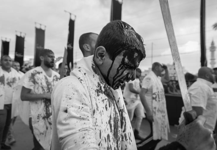 """Shia men taking part in the bloodletting rite known as """"tatbir"""" in Nabatiyeh, Lebanon, November 2014 (photo: Maya Hautefeuille)"""