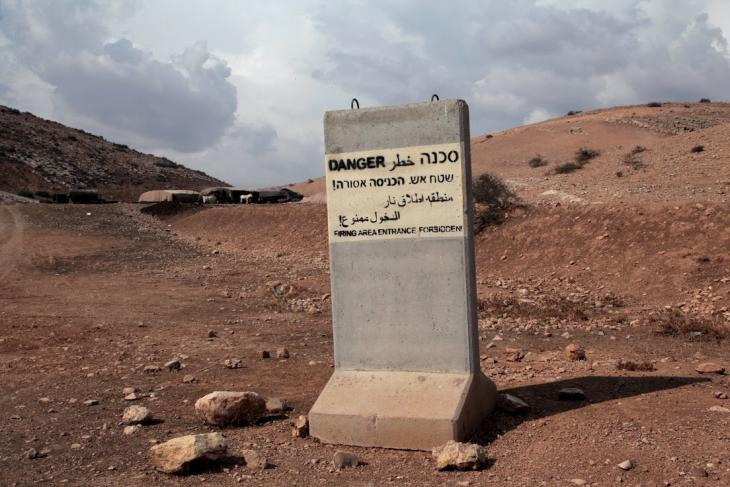 An Israeli military sign placed on Bedouin-inhabited land, West Bank, October 2014 (photo: Mohammad Alhaj)