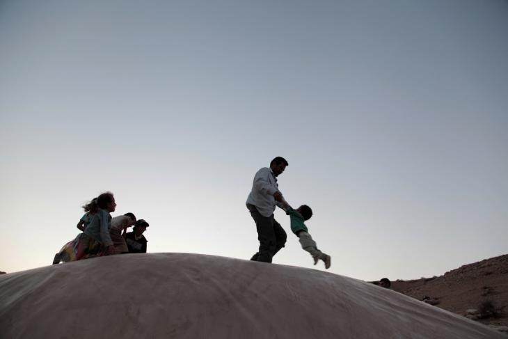 A Bedouin man plays with his children, Al-Maleh, West Bank, October 2014 (photo: Mohammad Alhaj)